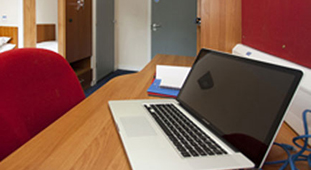 Image of laptop on desk in accommodation room